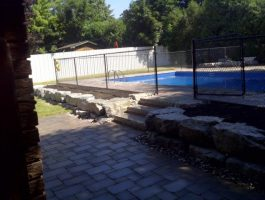 backyard-patio-by-zylstra-with-natural-stone-wall